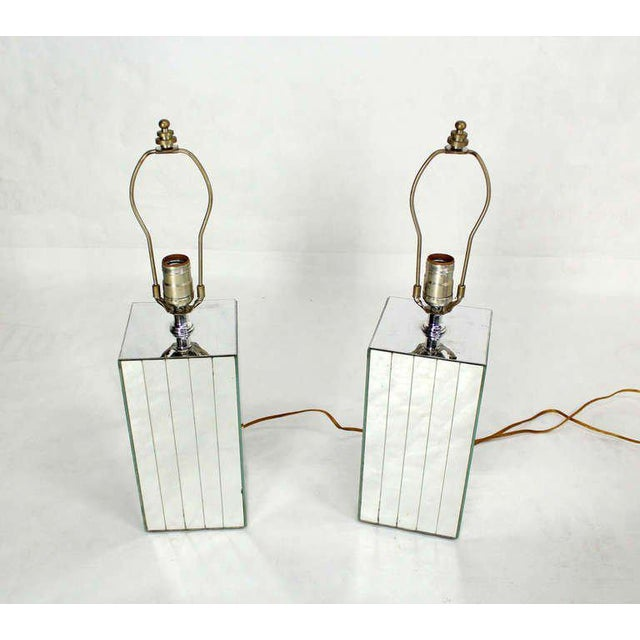 Pair of vintage mid-century mirrored tables lamps. The pieces are cube shaped.