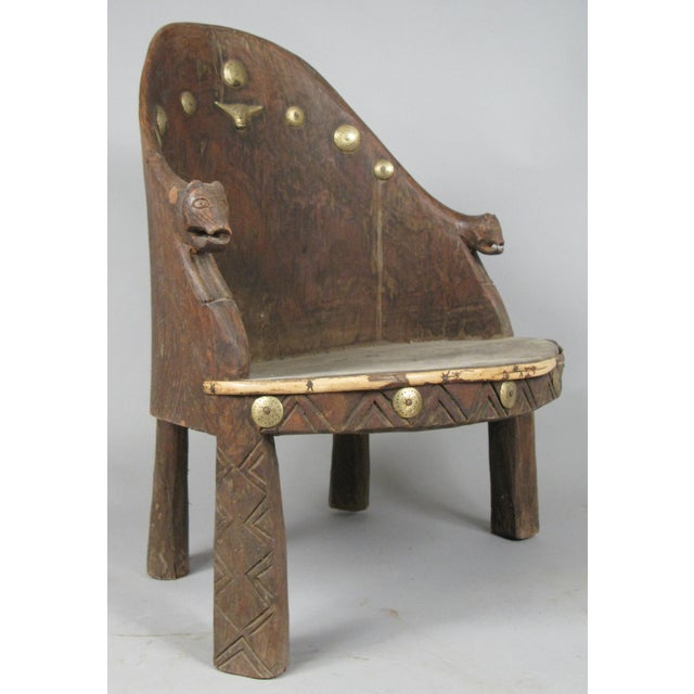 An outstanding chief's chair from Nagaland in northeast India. This chair, carved from a single piece of wood, has a...