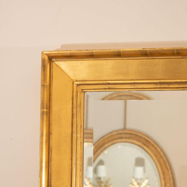 A late 19th century water-gilt frame with a later bevelled mirror. This beauty has aged to a wonderful warm finish and has...
