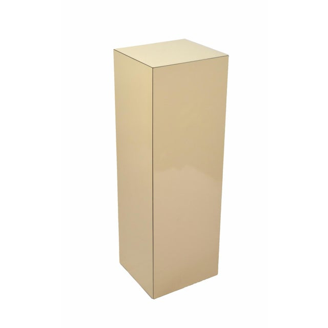 Versatile and handy modern pedestal, perfect for sculptures or plants. Heavy and solid with beige laminate. Measures 36in...