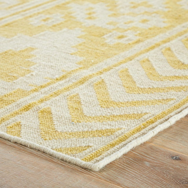 This hand-woven flatweave area rug offers bohemian style to modern spaces. Bands of geometric shapes and contemporary ikat...