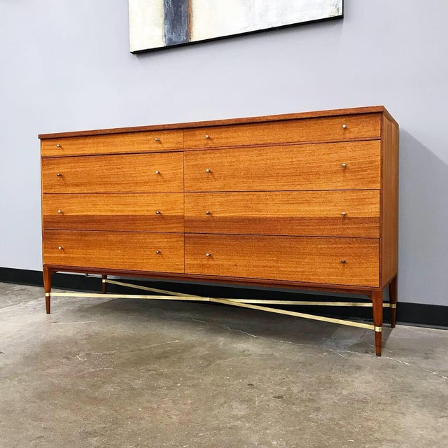 Beautiful and rare mahogany dresser designed by Paul McCobb for Calvin furniture in the 1950's. This is a wonderful...