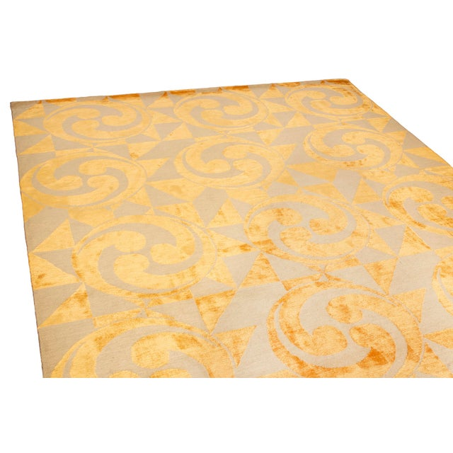 Rug & Kilim's stunning Kaleidoscope pattern in golden silk will be the center of attention. The swirls combined with the...