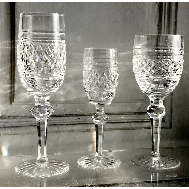 A rare 18 piece set of Waterford Castletown pattern Crystal fills up the holiday table with every course with three sizes...
