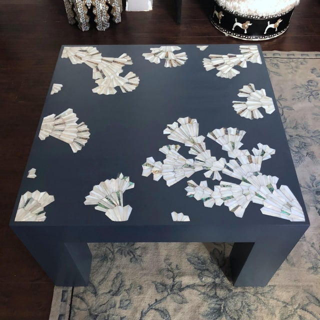 Contemporary square coffee table in sophisticated blue color and natural mother-of-pearl inlay. The inlay design of this...