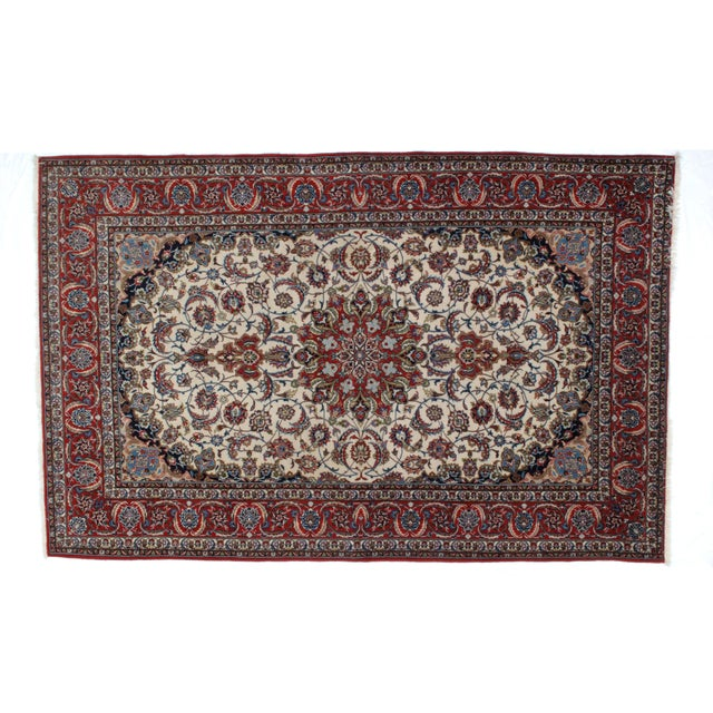 This master piece is a Silk and kork wool pile hand made very fine Persian Isphahan carpet in excellent condition. The...
