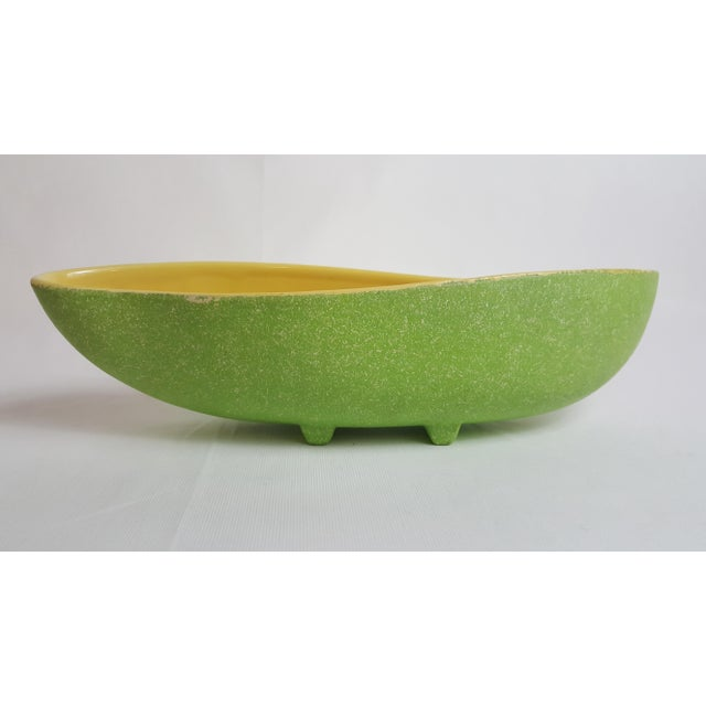 This stylish mid century Shawnee relish tray has a yellow High Gloss glaze on the interior and an apple green spekcle...