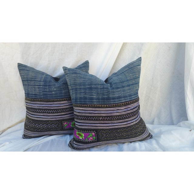 A pair of Hmong Hill tribe batik pillows with heavy embroidered areas. Hand spun and batiked. New nubby linen back. Zipper...