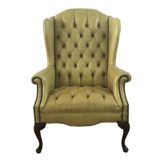 1970s Vintage Greenish Yellow Tufted Leatherette Wingback Chair For Sale