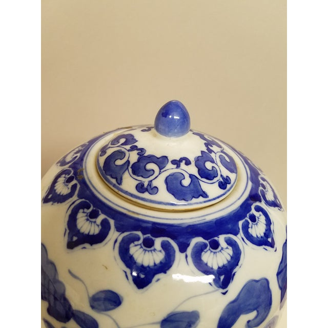Large lidded blue and white contemporary Chinese ginger jar with ginko leaf decoration.
