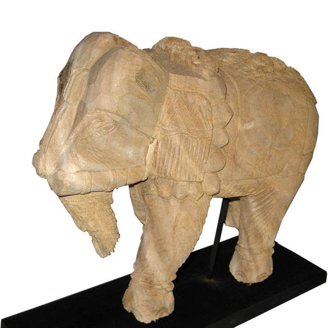 Hand-carved eroded elephant sits on a custom-made wood stand. Elephant with trunk down dispenses good luck to all....