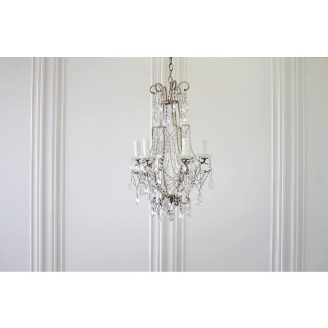 Vintage Macaroni Beaded Arm Chandelier SKU Number: F062-096543 1940s Italian gilt iron chandelier consisting of a crystal...