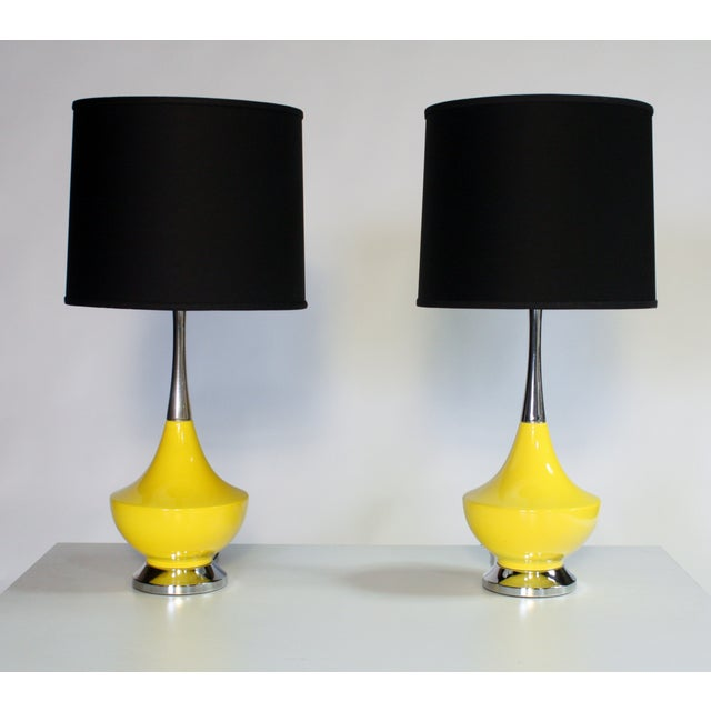 Vintage bright yellow ceramic and chrome genie-shape lamps. Excellent condition wired and in working condition. Shades not...