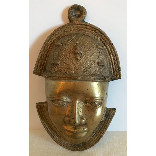 Nice heavy solid brass African Mask. Estate sale find.