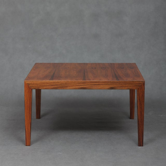 Executed in Rio Palisander, it has fantastic hight, a little lower than regular coffee tables. The pre-eminent rosewood...