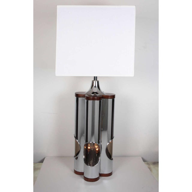 Mid-century lamps with quatrefoil or clover design. Comprised of four sides in tubular polished chrome metal. Lamps have...