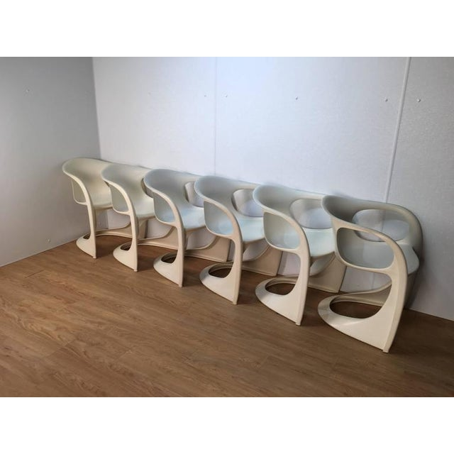 See of six Steen Ostergaard chairs. Excellent original condition with wonderful off-white patina. Very comfortable and can...