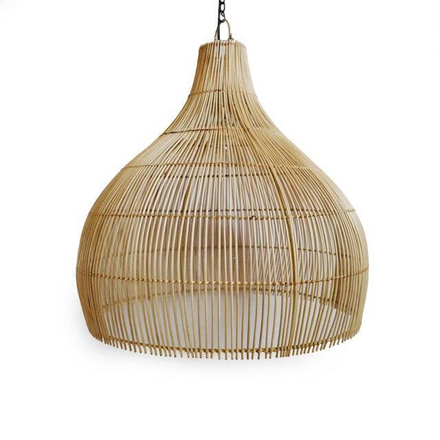 Natural raw rattan stick lantern with a modern gourd shaped form. Simple design with beautiful light patterns. Includes...