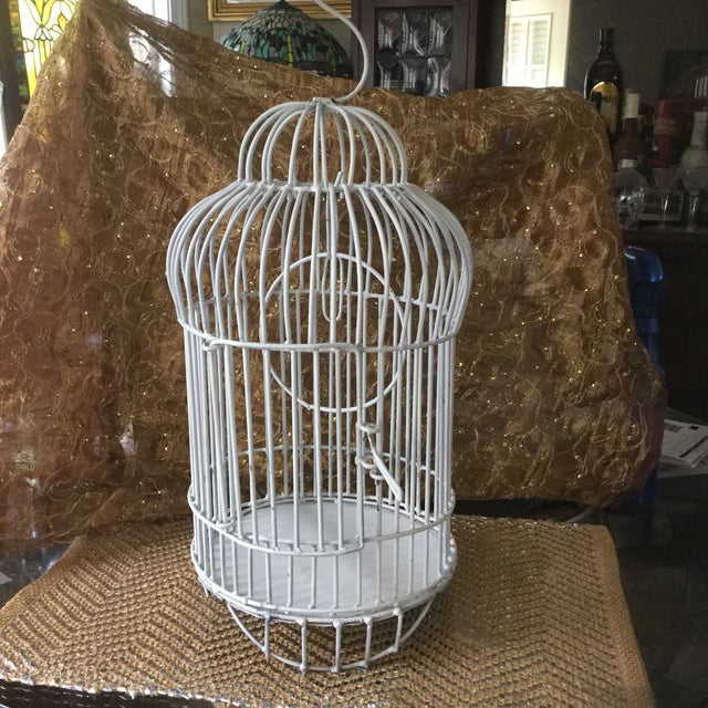 Vintage well made metal birdcage is a mid-century delight with its graceful design. The round metal perch along with its...