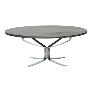 A Falcon coffee table in chromed steel and slate