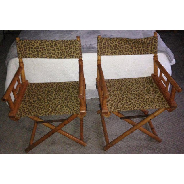 Directors chairs, pair, upholstered in leopard print design fabric. Made by Telescope Chair Company. Midcentury. Sturdy,...