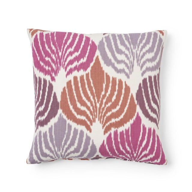"""This 18"""" x 18"""" pillow features Kimono Ikat in Berry. This splendid warp-printed ikat that was inspired by an antique robe..."""