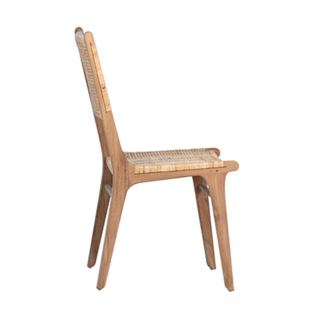Modern teak and wicker woven dining chair. Beautiful smooth sanded teak wood with natural finish wicker seat and back....