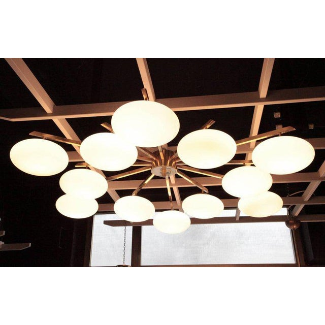 Monumental and impressive brass and white opaline glass flush mount or ceiling lamp. The lamps are in very good condition....
