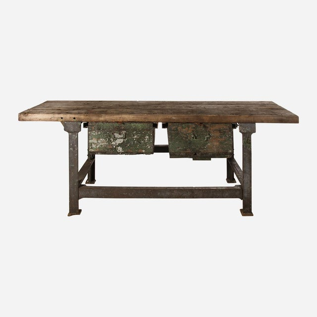 Industrial work table with iron base and two drawers. Wood top. Circa 1940 from Poland.