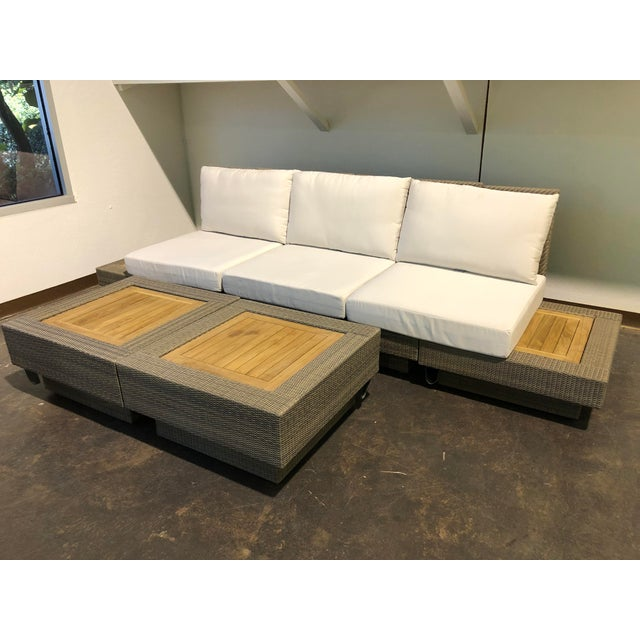 This six (6) piece outdoor sectional features woven Viro fiber over powder-coated aluminum frame. The square teak inserts...