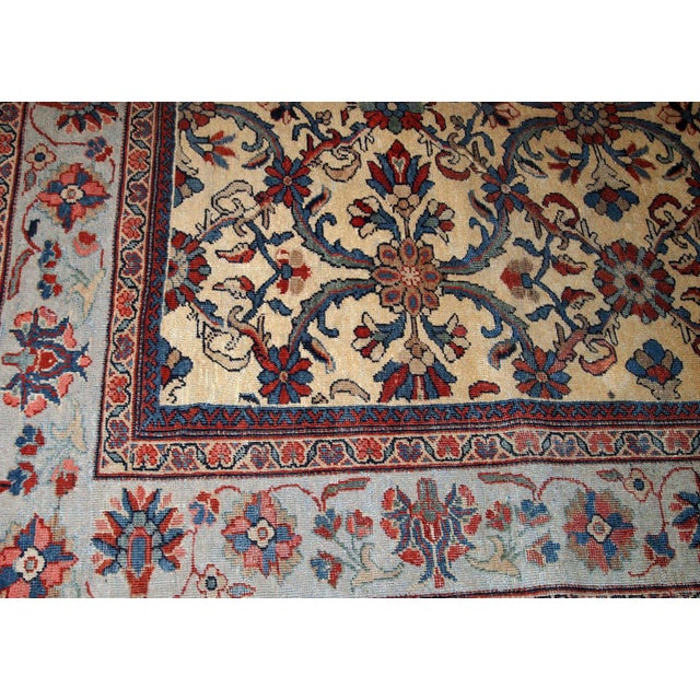 Hand made antique Persian Mahal rug in yellow wool and with open field design. The rug is from the beginning of 20th...