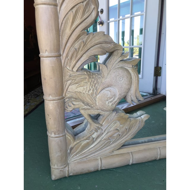 Stunning large Faux Bamboo Carved leaf wood mirror with a beautifully detailed carved Phoenix bird. The detail on this...