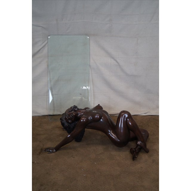 Glass top coffee table with a bronze nude female figured base. AGE/COUNTRY OF ORIGIN: Approx 25 years, Unknown...