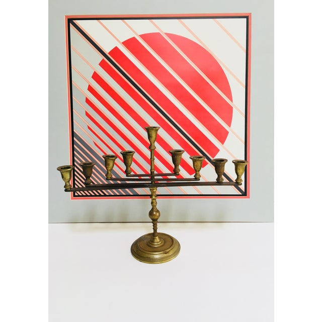Abstract geometric articulating modernist design. This Menorah or candelabra or candle holder holds nine candles. It makes...