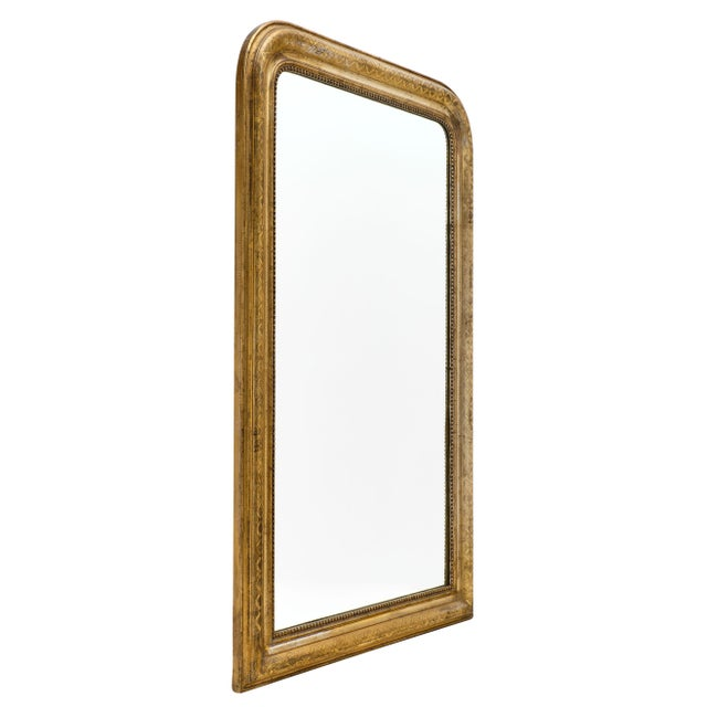 Antique French Louis Philippe period mirror made of wood and stucco with 23 carat gold leaf and finely chiseled frame. We...