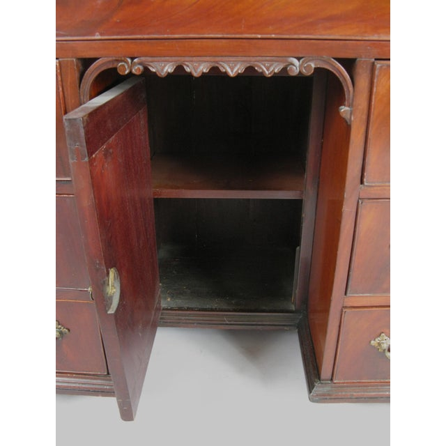 A beautiful antique English mid-19th century Georgian writing desk, with lovely scrolled base, and a locking interior...