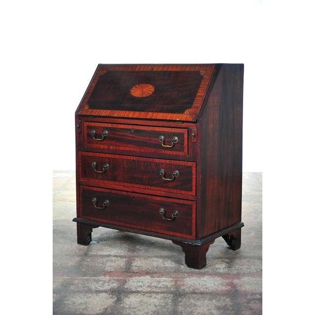 19th century antique English inlaid mahogany drop front secretary desk with three drawers.