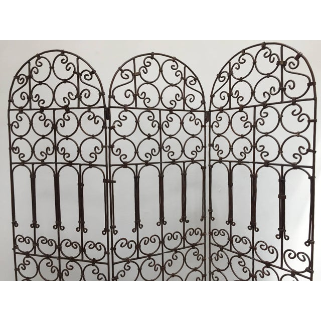 Hand-forged folding Moroccan screen with three panels decorated with Moorish designs. Classic and elegant Art & Craft this...