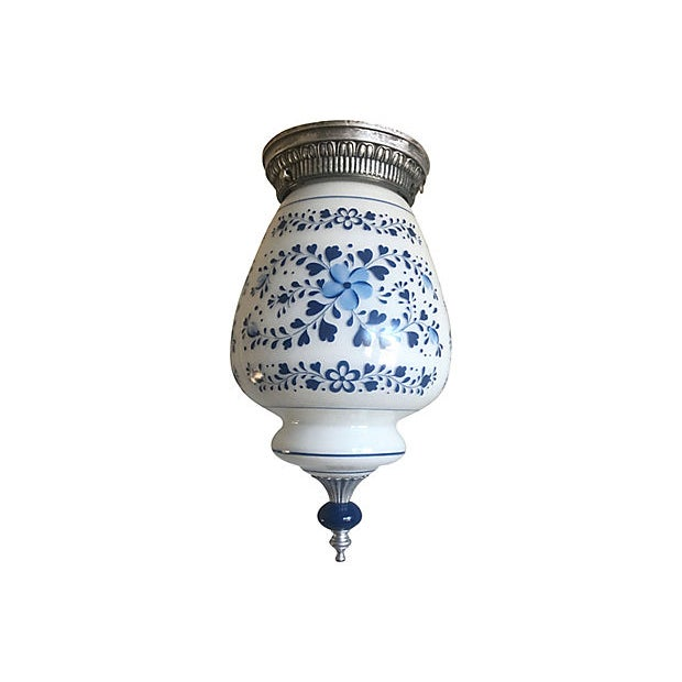Mid Century floral milk glass flush light by Halcolite featuring hand-painted blue flowers and striped borders on its...