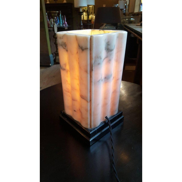 Pink marble Art Deco Lamp (circa 1930s). Beautiful and heavy French pink marble table lamp with black veining upon a black...