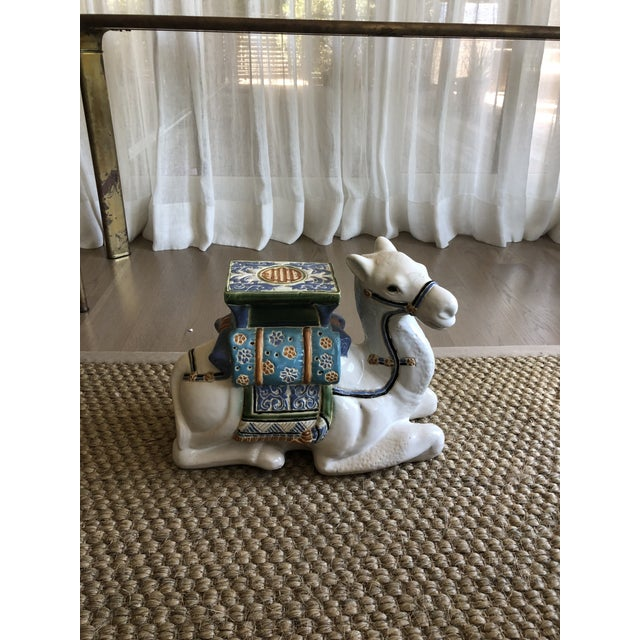 Colorful vintage ceramic camel. In great condition, no chips or fading. Perfect as a sculptural accent or a small side table.