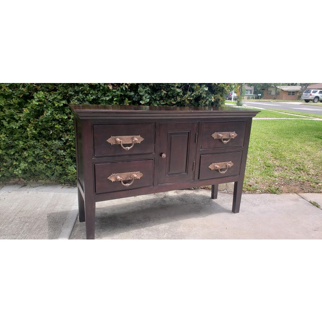 This vintage Asian Indian handcrafted sideboard/buffet was purchased in Dubai. The deep coffee wood tones and beautiful...
