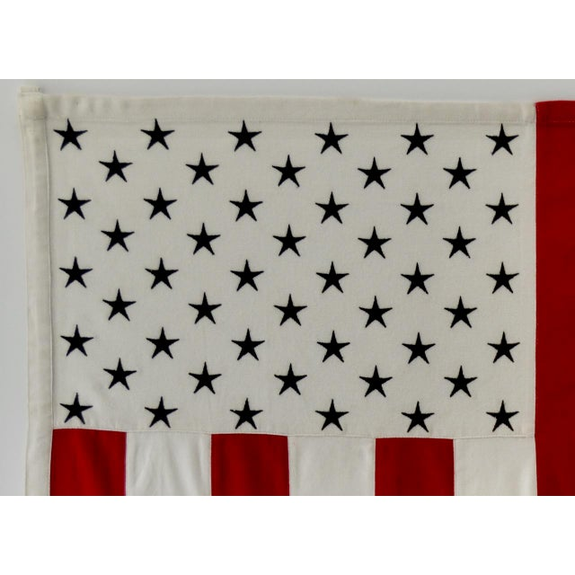 Our creation of a modern American Flag. The colors are red & white stripes with embroidered blue stars. The flag is a...