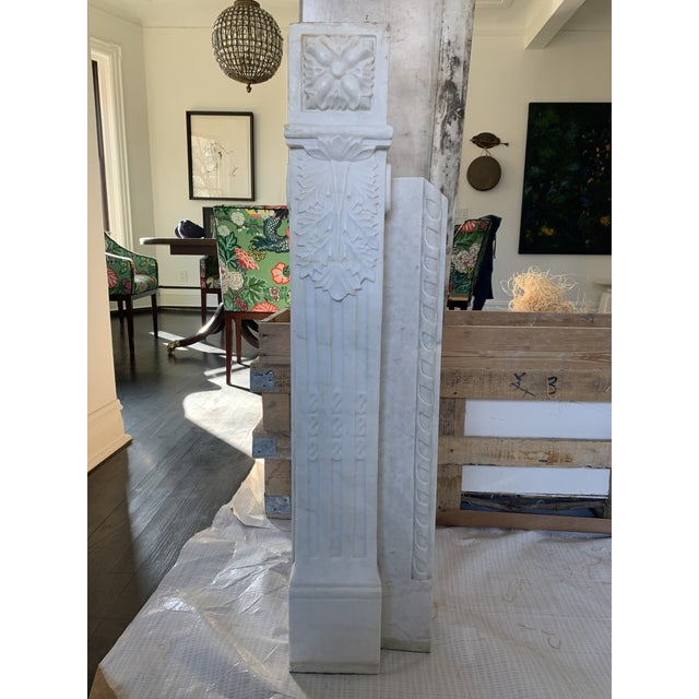 Beautifully hand carved white marble fireplace surround from the early 1900s. Currently is excellent condition. 8 pieces....