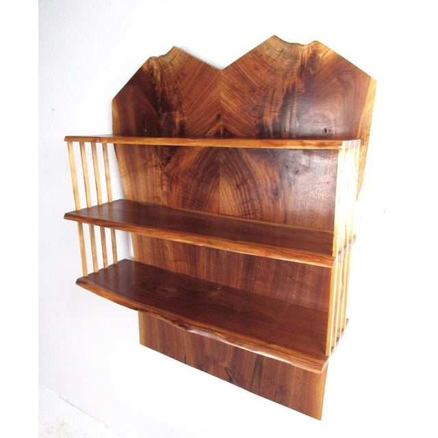 This impressive handmade wall shelf features rich hardwood construction with beautiful wood grain and rustic live edge...