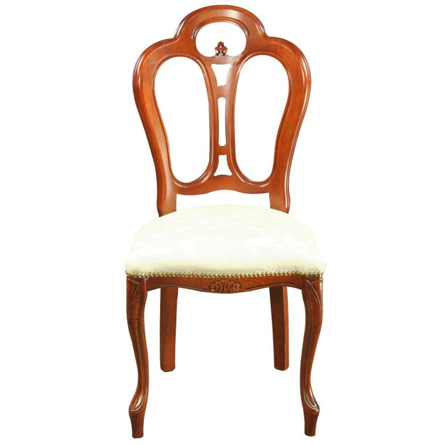 Add functionality and elegance to your home with this versatile reproduction Rococo dining chair! Crafted of mahogany, the...