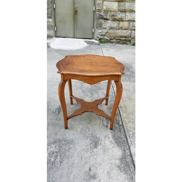 This 2 tiers serpentine wood side table has a rustic feeling but will work in any traditional decor.