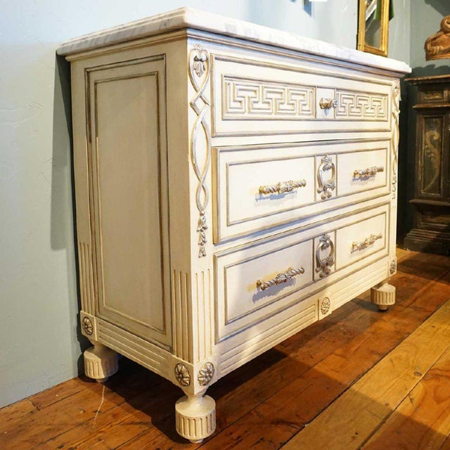 Villa Lorenzo hand carved chest in antique white finish with white gold carvings. Marble top chest of drawers. Model:...
