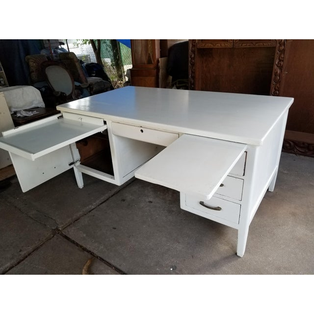 Mid century modern desk, central drawer with a door to the left that open to reveal a type writer shelf that can be pulled...
