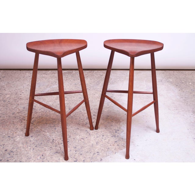 Pair of New Hope-Style walnut bar stools manufactured by David Scott in 1982. While Scott remains a noted name in...